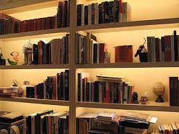 bookcase lighting can best be accomplished using low profile linear strips that illuminate the contents of shelves from within but remain hidden themselves cabinet lighting custom fixtures