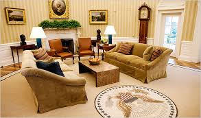 the new oval office features fawn colored cotton velvet sofas a mica coffee table and a rug ringed with inspirational quotes credit doug millsthe new carpet oval office inspirational