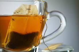 adding tea bags to the water for Lemon iced tea recipe