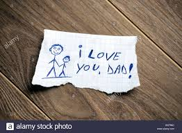 love written on paper stock photos love written on paper stock i love you dad written on piece of paper on a wood background