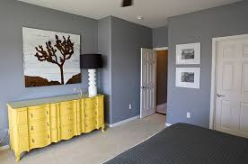 yellow and gray bedroom:  bedroom in granite gray along with a delightful yellow dresser photography michelle rasmussen