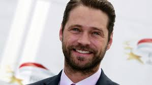 "Jason Priestley who stars in the television series ""Call Me Fitz"" poses during a photocall at the 51st Monte Carlo television festival in Monaco. (Reuters) - jason%2520priestley%2520smile%2520beard%2520reuters"