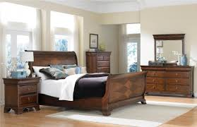 bedroom colors with brown furniture including antique sideboard cabinet below light blue ceramic vase nearby wood bedroom sideboard furniture