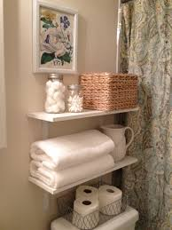 guest bathroom towels: floating shelves ideas ideas nubeling furniture bathroom alluring decorative bathroom wall shelves with wooden simple floating shelves and nice wicker basket guest bathroom ideas also beautiful flower painting on cream wall paint for com