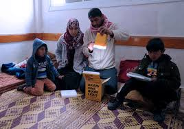 Solar lights help Gaza     s young do homework at night   UNRWA Solar lights help Gaza     s young do homework at night