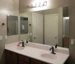 how to frame a mirror the builders installed a moms take bathroom mirrors