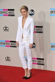 8 ways to wear the pant suit miley cyrus opts for a versus versace white pant suit cropped trousers photo