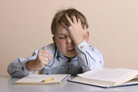 Image of boy frustrated by writing