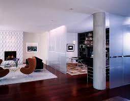 lincoln park residence modern living room idea in chicago with white walls and a standard fireplace beautiful living room pillar
