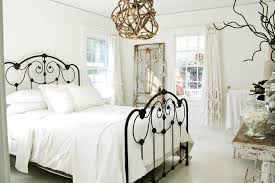 wrought iron bed in bedroom shabby chic with distressed furniture beach cottage beach shabby chic furniture