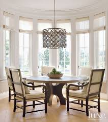 a pendant by ironies hangs above a gregorius pineo table which anchors the sunny breakfast nook the armchairs are from formations see more breakfast nook lighting ideas