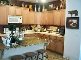 dishy kitchen counter decorating ideas: microwave cabinet and small wood bar stools with wall painting full size umiddot kitchen island with cool decor