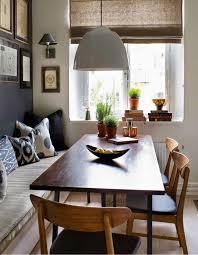 dining table interior design kitchen: dining room modern organic woven shades built in bench gallery wall large pendant over table wood dining set