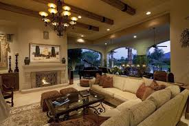 luxurious living room fully open to an immense patio space at right stands large beige beige sectional living room