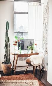 modern desk chair with faux fur and small wooden desk with tall potted cactibeautiful minimal home office spaces and home organisation beautiful home offices workspaces beautiful