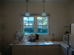 appealing kitchen pendant lights for white cabinet with dining table and black exquisite fixtures light lighting countertop along glass windo appealing pendant lights kitchen