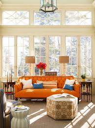 charming living room design idea with orange sofa white blue throw pillows and light brown floor charming living room lights