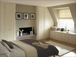ideas fascinating attic bedroom with sloped ceiling wardrobe also attractive windows plus simple cabinet beautify attic bedroom furniture