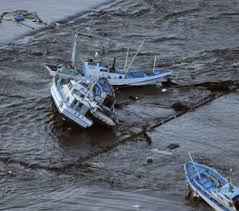 about this photo essay 0 fishing boats get stranded on shore at oarai town ibaraki prefecture state after a ferocious tsunami spawned by