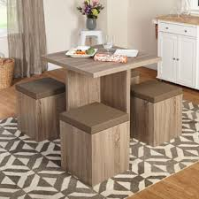 modern wood dining room sets: simple living  piece baxter dining set with storage ottomans