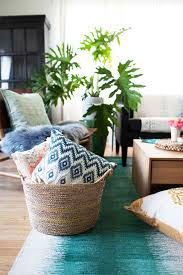 this bohemian living room makeover transforms a neutral space into a layered oasis with plants pillows and a few thoughtful details bohemian style living room