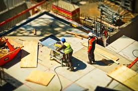 2 man on construction site during daytime · stock photo