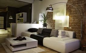 amazing modern living room design idea with white sofa with black sofa accent plus gray throw pillows and brown brick wall with silver floor lamp and also amazing modern living