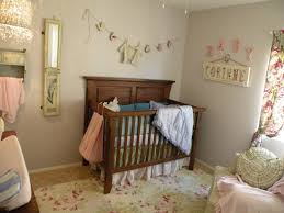 chic minimalist vintage eclectic girls baby room decor with wooden crib and floral rugs design idea baby nursery girl nursery ideas modern