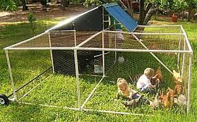 Free Chicken Coop Plans for Building One This WeekendPicture of kids and chickens in a chicken coop