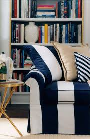striped white and black couch with piilows and bookcase black and white striped furniture