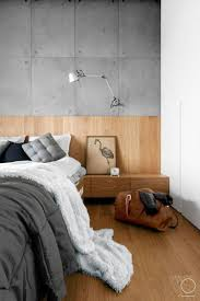 modern bedroom concepts: concrete and wooden details for modern bedroom style by oikoi studio