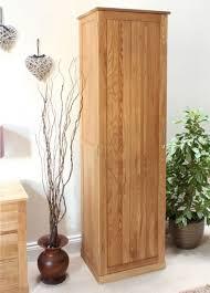 image of the baumhaus mobel oak tall shoe cupboard cor20e with doors closed baumhaus mobel oak 2