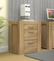 break away from the mould of metal filing cabinets and keep your home office chic with atlas chunky oak hidden home office