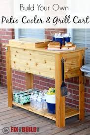 build a diy patio cooler and grill cart combo host your next bbq grilling session in style with the cooler box holding the drinks and the barbecue station apothecary style furniture patio