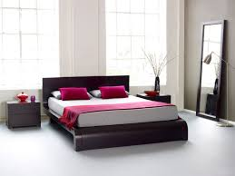 red wall paint black bed: wth elegant color with white bed linen and red bedcover also black