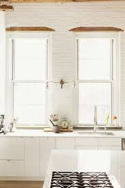 white kitchen windowed partition wall: white wood windows  white wood windows