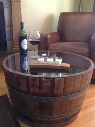 reclaimed half wine barrel table with tempered glass top we used some barrels to plant arched table top wine cellar furniture