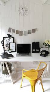 garden studio small scandinavian study room idea in london with white walls painted wood floors and black white home office study