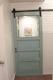 this would solve that laundry room after replaced regular opening door with a sliding door therefore saving space laundry room beach style beach style laundry room