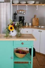 sink tips diy kitchen art tutorial  butcher block countertops mismatched knobs aqua islandthis is good in