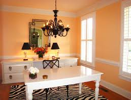 home office transitional home office photo in other with orange walls dark hardwood floors and a carpet oval office inspirational