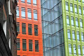 central st giles orange and glass facade against older neighbouring building central saint giles office building google