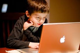 Child Surfing the Internet on a Mac Book