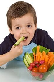 Image result for pictures of a child eating vegetables