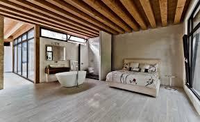 ecologia montreal rustic master bedroom idea in montreal with beige walls and medium tone hardwood floors bathroom winsome rustic master bedroom designs