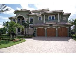 Buckman Heights Spanish Home Plan S    House Plans and MoreMulti Level Spanish Stucco Home With Tile Roof
