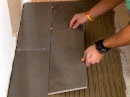 Laying Kitchen Floor Tiles How To Install A Plank Tile Floor How Tos Diy