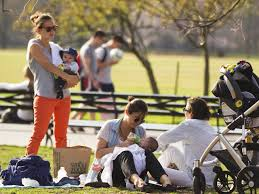 social darwinism thin white women in a park tending to children