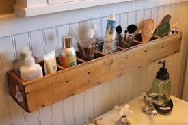 bathroom box wooden divided box mounted above a sink and storing various bathroom grooming and hygiene
