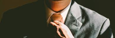 7 must tips for acing the finance interview tapwage job search a person in a suit fixing his tie before going in to interview for a job
